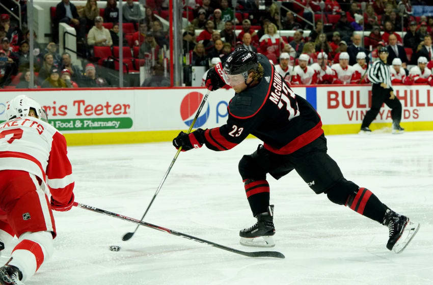 RALEIGH, NC - NOVEMBER 1: Brock McGinn #23 of the Carolina Hurricanes shoots and scores a short-handed goal during an NHL game against the Detroit Red Wings on November 1, 2019 at PNC Arena in Raleigh, North Carolina. (Photo by Gregg Forwerck/NHLI via Getty Images)