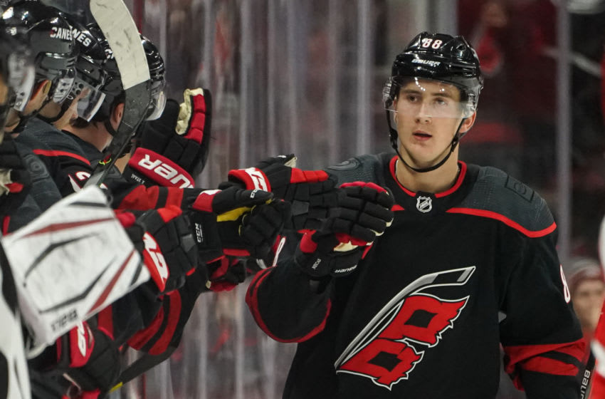 RALEIGH, NC - NOVEMBER 01: Carolina Hurricanes Right Wing Martin Necas (88) is congratulated by teammates after scoring during a game between the Detroit Red Wings and the Carolina Hurricanes on November 1, 2019 at the PNC Arena in Raleigh, NC. (Photo by Greg Thompson/Icon Sportswire via Getty Images)