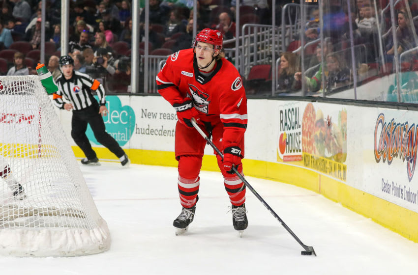CLEVELAND, OH - NOVEMBER 03: Charlotte Checkers defenceman Alex Lintuniemi (4) plays the puck during the second period of the American Hockey League game between the Charlotte Checkers and Cleveland Monsters on November 3, 2019, at Rocket Mortgage FieldHouse in Cleveland, OH.(Photo by Frank Jansky/Icon Sportswire via Getty Images)