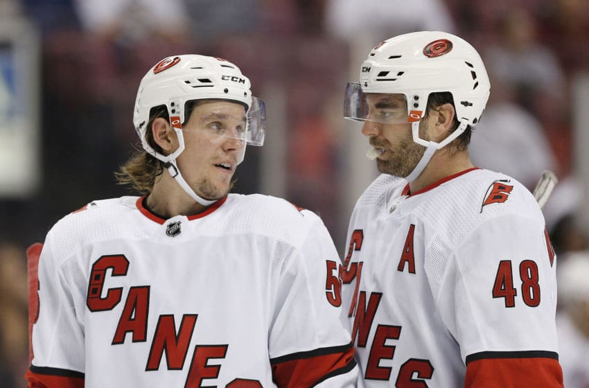 SUNRISE, FLORIDA - OCTOBER 08: Erik Haula #56 and Jordan Martinook #48 of the Carolina Hurricanes talk during a pause in the against the Florida Panthers in the third period at BB&T Center on October 08, 2019 in Sunrise, Florida. (Photo by Michael Reaves/Getty Images)