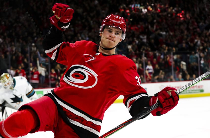 RALEIGH, NC - DECEMBER 05: Carolina Hurricanes right wing Andrei Svechnikov (37) celebrates his goal at the end of the OT period of the Carolina Hurricanes game versus the New York Rangers on December 5th, 2019 at PNC Arena in Raleigh, NC (Photo by Jaylynn Nash/Icon Sportswire via Getty Images)
