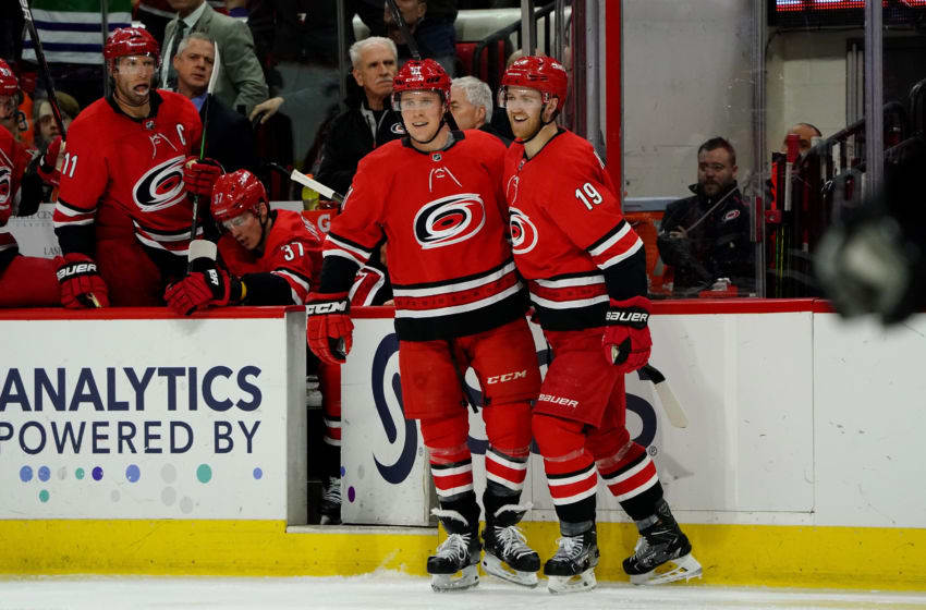 RALEIGH, NC - JANUARY 7: Jake Gardiner #51 of the Carolina Hurricanes celebrates with teammate Dougie Hamilton #19 after scoring a goal during an NHL game against the Philadelphia Flyers on January 7, 2020 at PNC Arena in Raleigh, North Carolina. (Photo by Gregg Forwerck/NHLI via Getty Images)