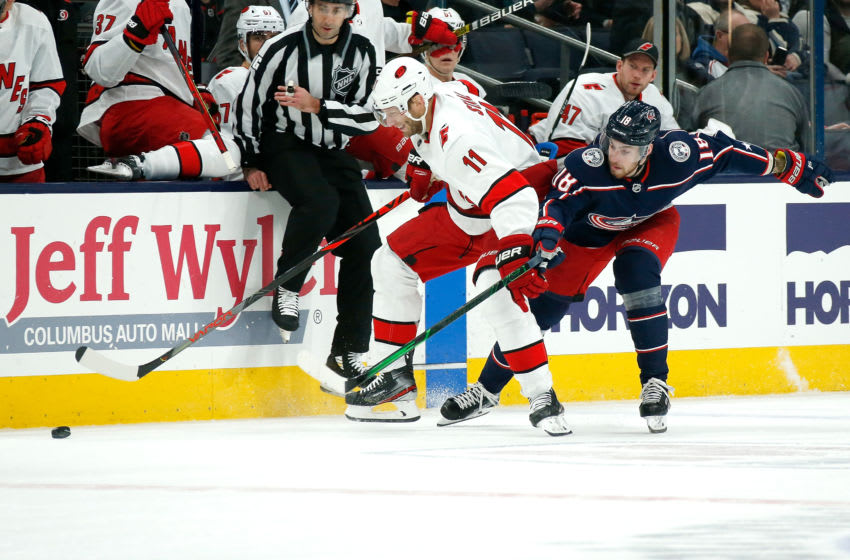 COLUMBUS, OH - JANUARY 16: Jordan Staal #11 of the Carolina Hurricanes and Pierre-Luc Dubois #18 of the Columbus Blue Jackets battle for control of the puck during the first period on January 16, 2020 at Nationwide Arena in Columbus, Ohio. (Photo by Kirk Irwin/Getty Images)