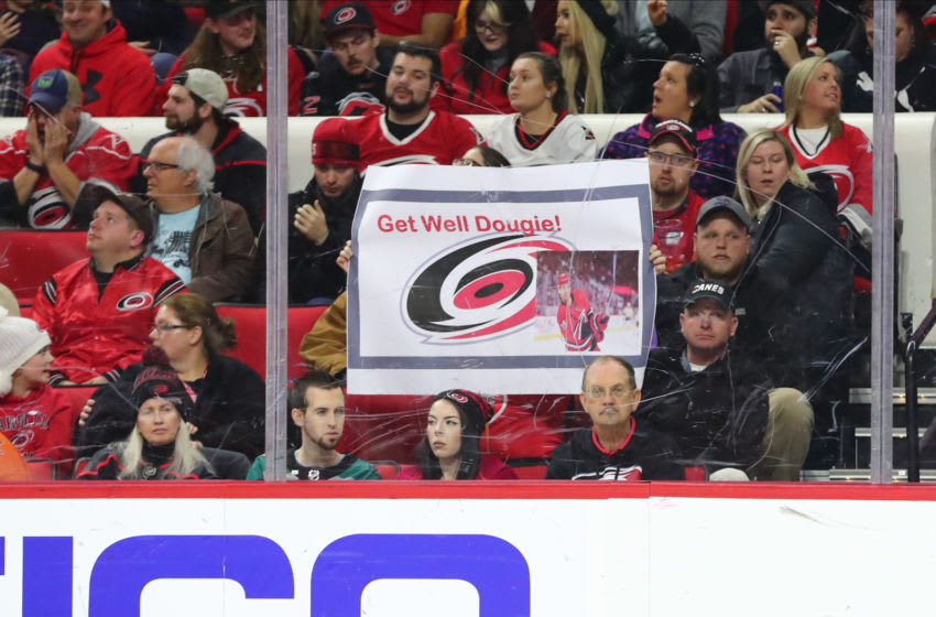 RALEIGH, NC - JANUARY 17: Carolina Hurricanes fan sign for Carolina Hurricanes defenseman Dougie Hamilton (19) during the 3rd period of the Carolina Hurricanes game versus the Anaheim Ducks on January 17th, 2020 at PNC Arena in Raleigh, NC (Photo by Jaylynn Nash/Icon Sportswire via Getty Images)