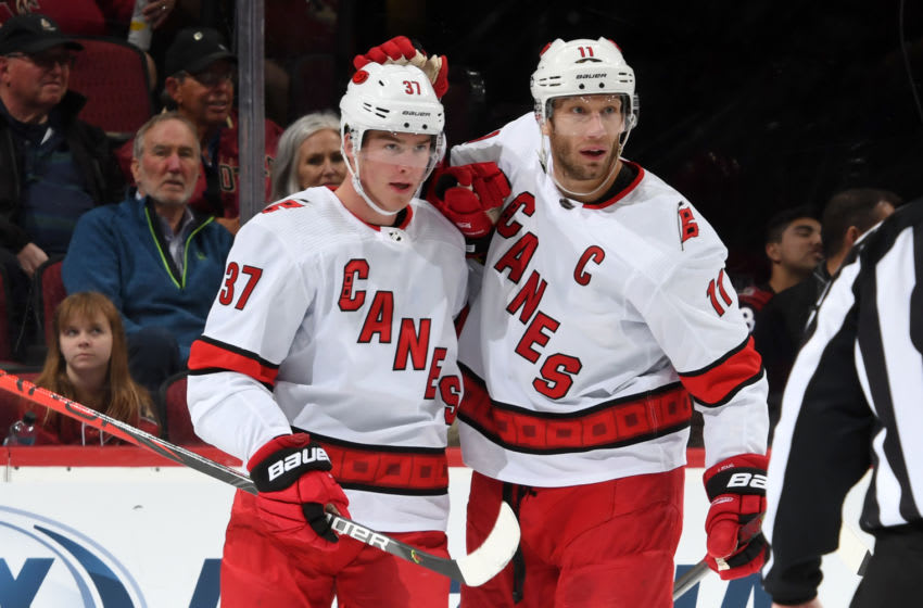 GLENDALE, ARIZONA - FEBRUARY 06: Andrei Svechnikov #37 of the Carolina Hurricanes is congratulated by teammate Jordan Staal #11 of the Hurricanes after scoring a goal against the Arizona Coyotes during the second period of the NHL hockey game at Gila River Arena on February 06, 2020 in Glendale, Arizona. (Photo by Norm Hall/NHLI via Getty Images)