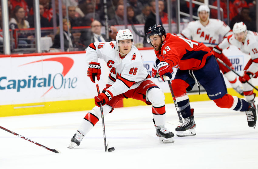 WASHINGTON, DC - JANUARY 13: Teuvo Teravainen #86 of the Carolina Hurricanes skates with the puck in front of Tom Wilson #43 of the Washington Capitals in the third period at Capital One Arena on January 13, 2020 in Washington, DC. (Photo by Rob Carr/Getty Images)