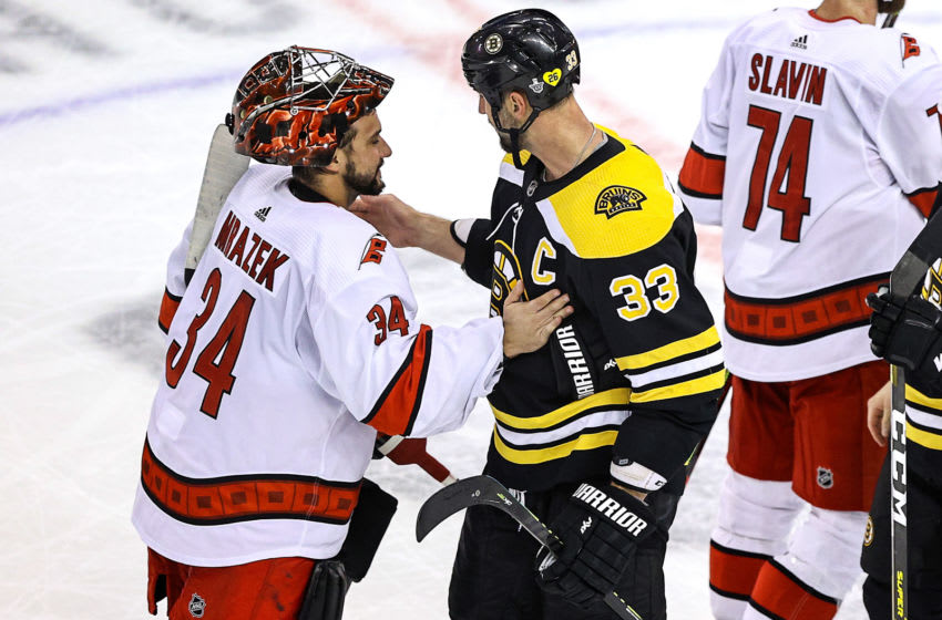 TORONTO, ONTARIO - AUGUST 19: Petr Mrazek #34 of the Carolina Hurricanes shakes hands with Zdeno Chara #33 of the Boston Bruins after the Bruins 2-1 win in Game Five of the Eastern Conference First Round during the 2020 NHL Stanley Cup Playoffs at Scotiabank Arena on August 19, 2020 in Toronto, Ontario. (Photo by Elsa/Getty Images)
