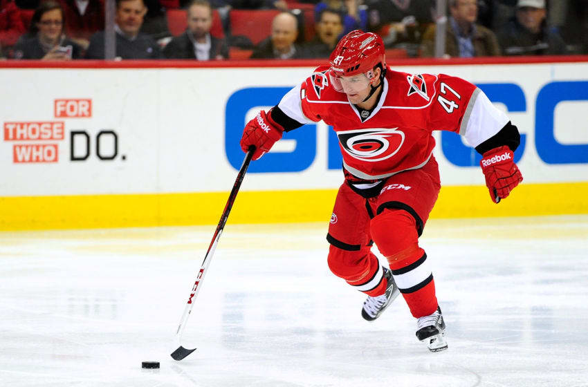 RALEIGH, NC - APRIL 04: Marc-Andre Bergeron #47 of the Carolina Hurricanes moves the puck against his former team, the Tampa Bay Lightning, during play at PNC Arena on April 4, 2013 in Raleigh, North Carolina. (Photo by Grant Halverson/Getty Images)