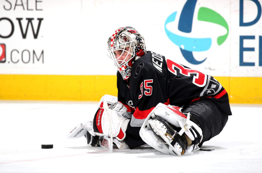 RALEIGH, NC - MARCH 30: Alex Nedeljkovic #35 of the Carolina Hurricanes is photographed during pregame warm ups prior to an NHL game on March 30, 2017 at PNC Arena in Raleigh, North Carolina. (Photo by Gregg Forwerck/NHLI via Getty Images)