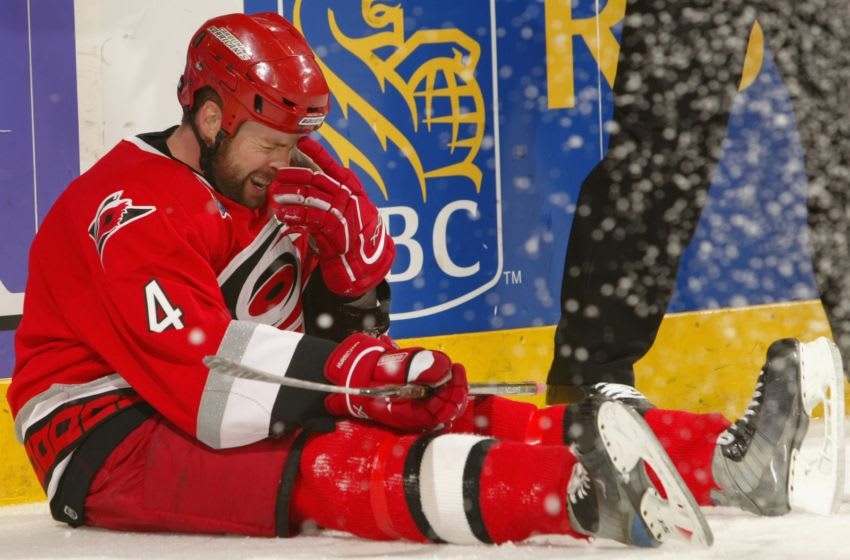 RALEIGH, NC - JUNE 07: Aaron Ward #4 of the Carolina Hurricanes reacts after falling to the ice during game two of the 2006 NHL Stanley Cup Finals against the Edmonton Oilers on June 7, 2006 at the RBC Center in Raleigh, North Carolina. (Photo by Elsa/Getty Images)