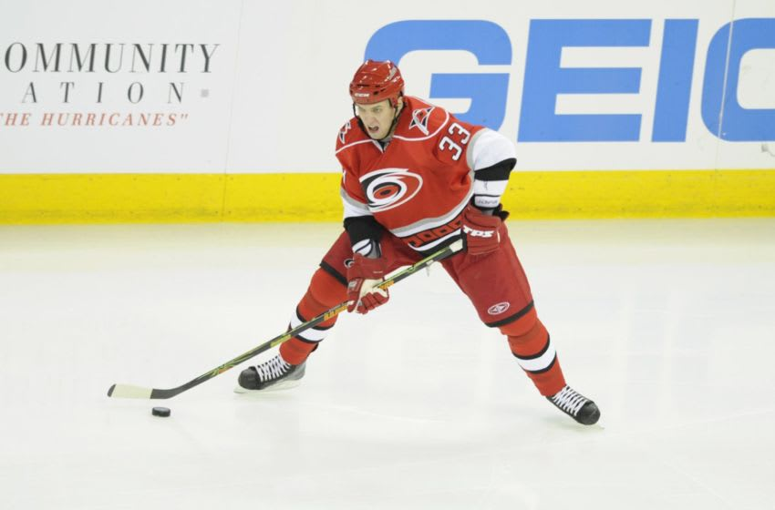 RALEIGH, NC - APRIL 19: Anton Babchuk #33 of the Carolina Hurricanes plays the puck against the New Jersey Devils during Game Three of the Eastern Conference Quarterfinals of the 2009 Stanley Cup Playoffs on April 19, 2009 at the RBC Center in Raleigh, North Carolina. New Jersey won 3-2 in overtime. (Photo by Grant Halverson/Getty Images)