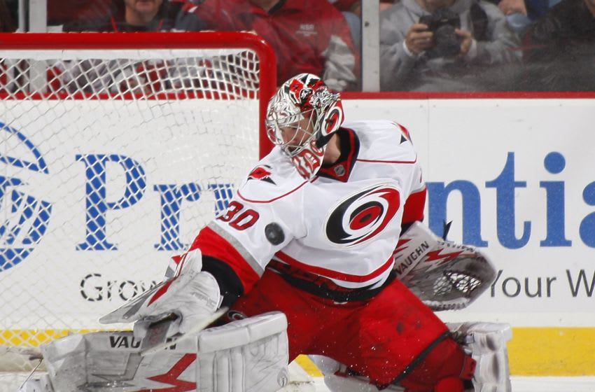 NEWARK, NJ - DECEMBER 09: Cam Ward #30 of the Carolina Hurricanes defends against the New Jersey Devils on December 9, 2009 in Newark, New Jersey. (Photo by Paul Bereswill/Getty Images)
