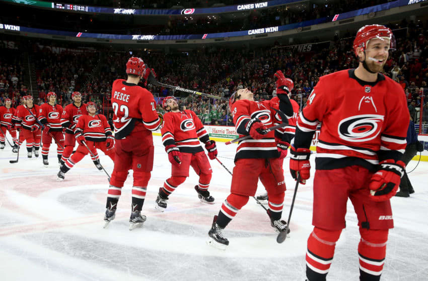 RALEIGH, NC - FEBRUARY 16: Members of the Carolina Hurricanes perform a limbo during the Storm Surge following a victory over the Dallas Stars during an NHL game on February 16, 2019 at PNC Arena in Raleigh, North Carolina. (Photo by Gregg Forwerck/NHLI via Getty Images)