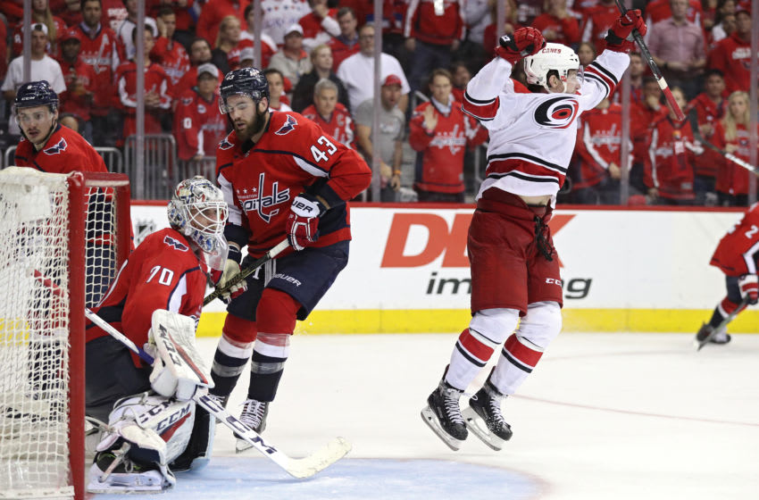 WASHINGTON, DC - APRIL 24: Brock McGinn #23 of the Carolina Hurricanes celebrates his game-winning goal with teammates against the Washington Capitals at 11:05 of the second overime period in Game Seven of the Eastern Conference First Round during the 2019 NHL Stanley Cup Playoffs at the Capital One Arena on April 24, 2019 in Washington, DC. The Hurricanes defeated the Capitals 4-3 in the second overtime period to move on to Round Two of the Stanley Cup playoffs. (Photo by Patrick Smith/Getty Images)