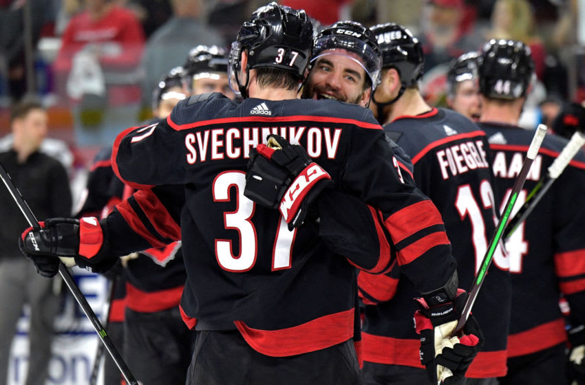RALEIGH, NORTH CAROLINA - MAY 03: Jordan Martinook #48 and Andrei Svechnikov #37 of the Carolina Hurricanes celebrate after a win against the New York Islanders in Game Four of the Eastern Conference Second Round during the 2019 NHL Stanley Cup Playoffs at PNC Arena on May 03, 2019 in Raleigh, North Carolina. The Hurricanes won 5-2 and won the series, 4-0. (Photo by Grant Halverson/Getty Images)