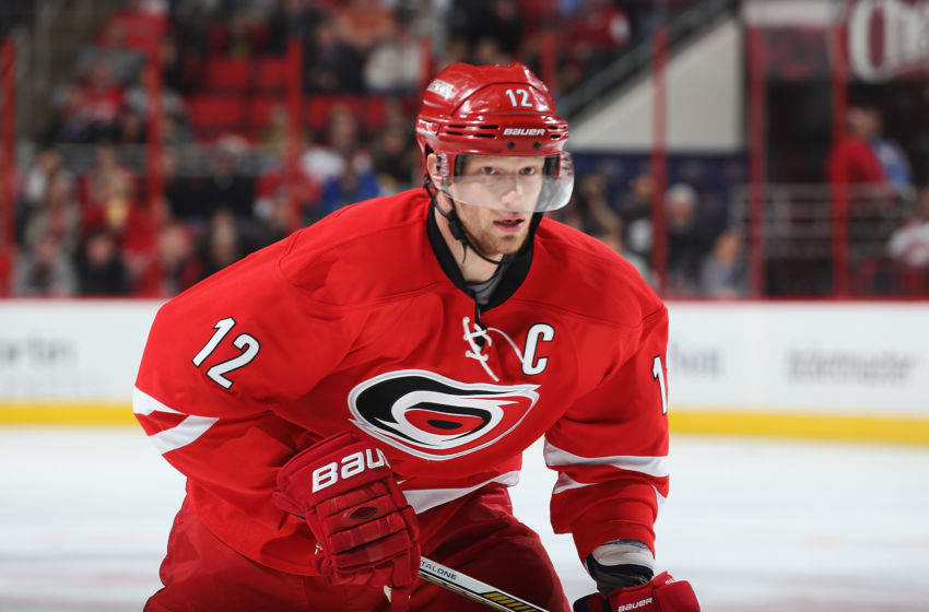 RALEIGH, NC - FEBRUARY 19: Eric Staal #12 of the Carolina Hurricanes skates for position on the ice during an NHL game against the San Jose Sharks at PNC Arena on February 19, 2016 in Raleigh, North Carolina. (Photo by Gregg Forwerck/NHLI via Getty Images)