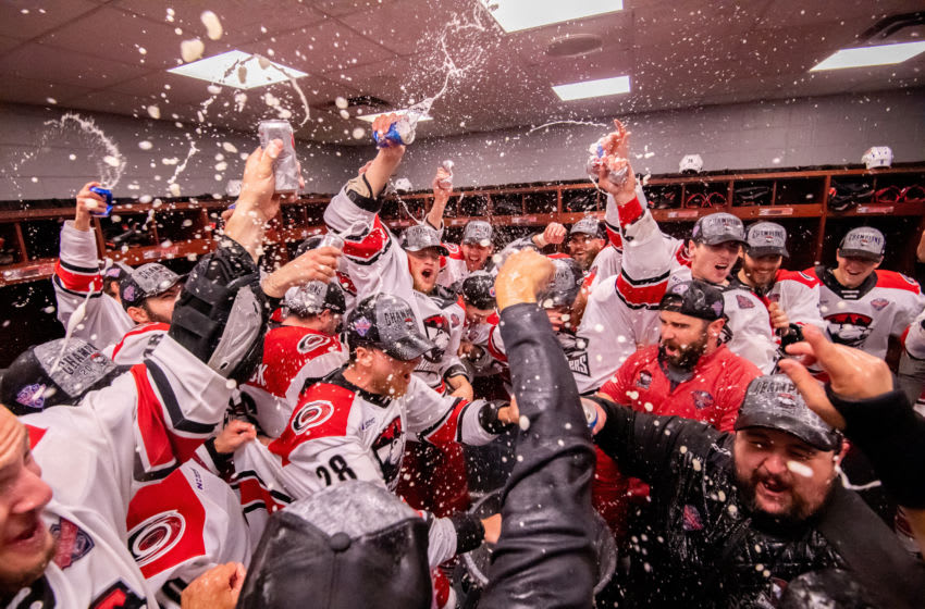 ROSEMONT, IL - JUNE 08: The Charlotte Checkers celebrate in the locker room after game five of the AHL Calder Cup Finals against the Chicago Wolves on June 8, 2019, at the Allstate Arena in Rosemont, IL. (Photo by Patrick Gorski/Icon Sportswire via Getty Images)