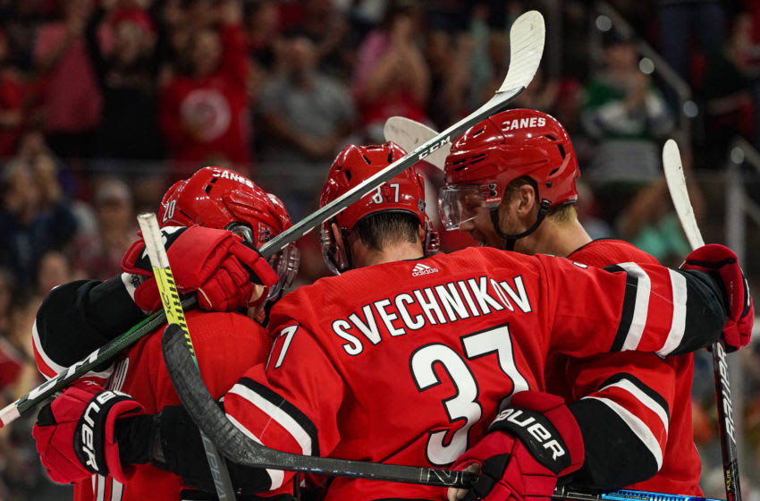 RALEIGH, NC - SEPTEMBER 29: Carolina Hurricanes right wing Andrei Svechnikov (37) celebrates with teammates during an NHL Preseason game between the Washington Capitals and the Carolina Hurricanes on September 29, 2019 at the PNC Arena in Raleigh, NC. (Photo by Greg Thompson/Icon Sportswire via Getty Images)