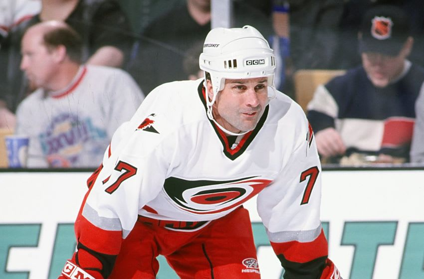 BOSTON, MA - 1990's: Paul Coffey #77 of the Carolina Hurricanes waits for a face off against the Boston Bruins at the Fleet Center in Boston. (Photo by Steve Babineau/NHLI via Getty Images)
