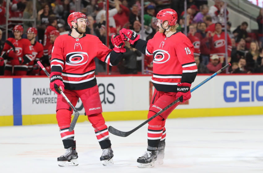 RALEIGH, NC - FEBRUARY 26: Carolina Hurricanes defenseman Dougie Hamilton (19) and Carolina Hurricanes defenseman Jaccob Slavin (74) celebrate a goal during the 1st period of the Carolina Hurricanes game versus the Los Angeles Kings on February 26th, 2019 at PNC Arena in Raleigh, NC. (Photo by Jaylynn Nash/Icon Sportswire via Getty Images)