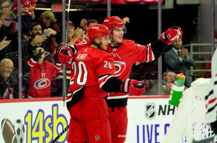 RALEIGH, NC - OCTOBER 26: Andrei Svechnikov #37 of the Carolina Hurricanes scores a goal and celebrates with teammate Sebastian Aho #20 an NHL game against the Chicago Blackhawks on October 26, 2019 at PNC Arena in Raleigh North Carolina. (Photo by Gregg Forwerck/NHLI via Getty Images)