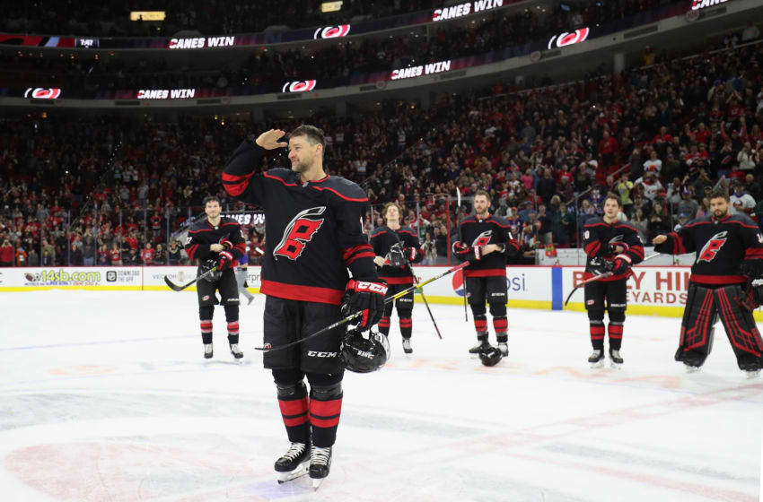 RALEIGH, NC - JANUARY 19: Justin Williams #14 of the Carolina Hurricanes salutes the fans during a Storm Surge on Military Appreciation Night following an NHL game against the New York Islanders on January 19, 2020 at PNC Arena in Raleigh, North Carolina. (Photo by Gregg Forwerck/NHLI via Getty Images)