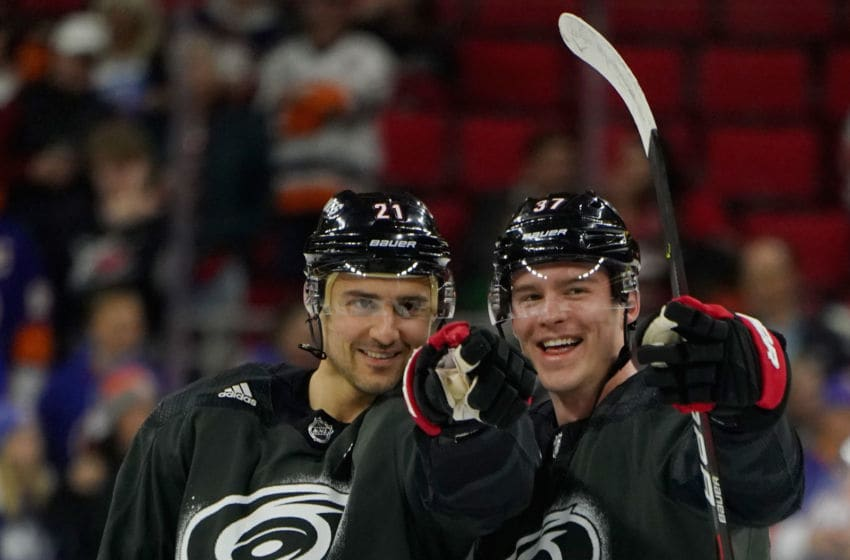 RALEIGH, NC - JANUARY 19: Andrei Svechnikov #37 of the Carolina Hurricanes acknowledges fans with teammate Nino Niederreiter #21 during warmups prior to an NHL game against the New York Islanders on January 19, 2020 at PNC Arena in Raleigh, North Carolina. (Photo by Gregg Forwerck/NHLI via Getty Images)