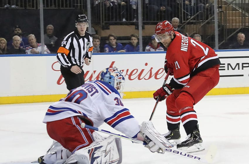 NEW YORK, NEW YORK - FEBRUARY 08: Nino Niederreiter #21 of the Carolina Hurricanes is stopped by Henrik Lundqvist #30 of the New York Rangers during the first period at Madison Square Garden on February 08, 2019 in New York City. (Photo by Bruce Bennett/Getty Images)