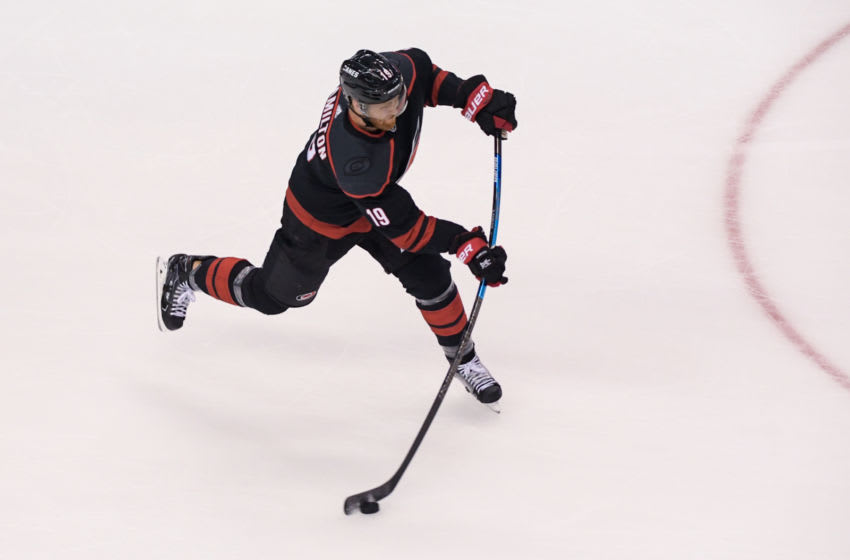 Aug 17, 2020; Toronto, Ontario, CAN; Carolina Hurricanes defenseman Dougie Hamilton (19) takes a shot during warmups prior to game four of the first round of the 2020 Stanley Cup Playoffs at Scotiabank Arena. Mandatory Credit: Dan Hamilton-USA TODAY Sports