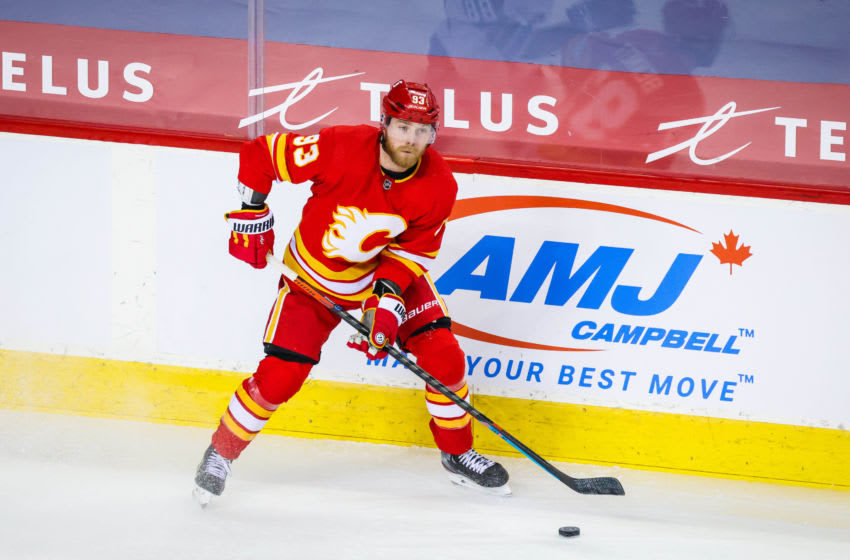 Feb 9, 2021; Calgary, Alberta, CAN; Calgary Flames center Sam Bennett (93) controls the puck against the Winnipeg Jets during the third period at Scotiabank Saddledome. Mandatory Credit: Sergei Belski-USA TODAY Sports