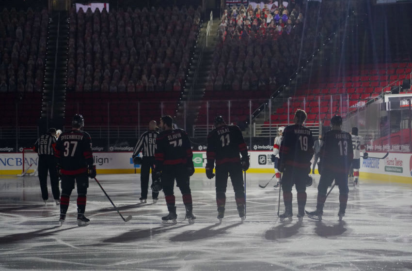 Feb 17, 2021; Raleigh, North Carolina, USA; Carolina Hurricanes right wing Andrei Svechnikov (37) and defenseman Jaccob Slavin (74) and center Jordan Staal (11) and defenseman Dougie Hamilton (19) and left wing Warren Foegele (13) look on during the playing of the National Anthem before a game against the Florida Panthers at PNC Arena. Mandatory Credit: James Guillory-USA TODAY Sports