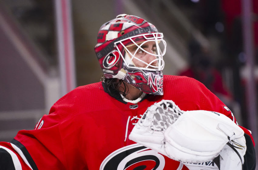 Feb 20, 2021; Raleigh, North Carolina, USA; Carolina Hurricanes goaltender Alex Nedeljkovic (39) looks on against the Tampa Bay Lightning during the third period at PNC Arena. Mandatory Credit: James Guillory-USA TODAY Sports