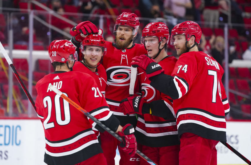 May 4, 2021; Raleigh, North Carolina, USA; Carolina Hurricanes right wing Andrei Svechnikov (37) is congratulated by defenseman Jaccob Slavin (74) defenseman Jani Hakanpaa (58) left wing Teuvo Teravainen (86) and right wing Sebastian Aho (20) after his second period goal against the Chicago Blackhawks at PNC Arena. Mandatory Credit: James Guillory-USA TODAY Sports