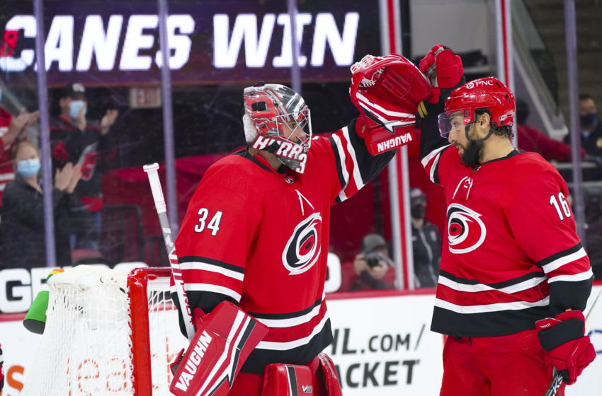 May 4, 2021; Raleigh, North Carolina, USA; Carolina Hurricanes goaltender Petr Mrazek (34) and center Vincent Trocheck (16) celebrate there win against the Chicago Blackhawks at PNC Arena. Mandatory Credit: James Guillory-USA TODAY Sports