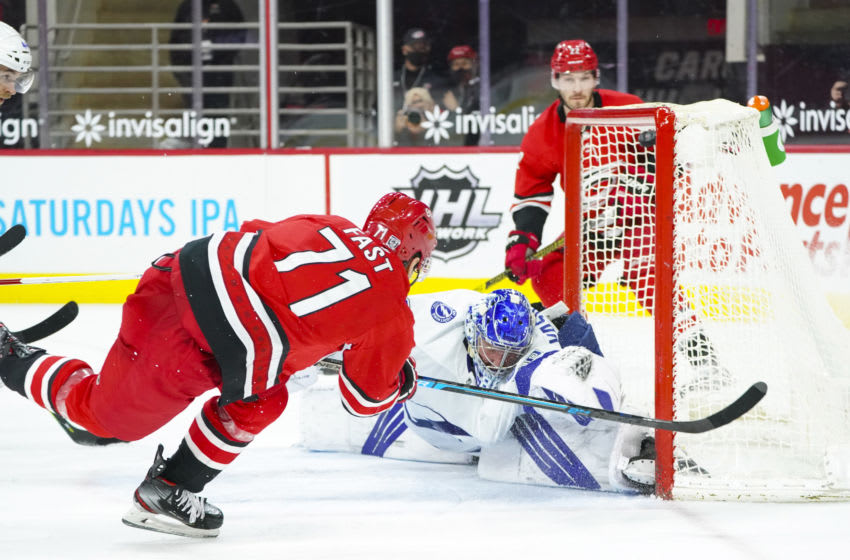 Feb 22, 2021; Raleigh, North Carolina, USA; Carolina Hurricanes right wing Jesper Fast (71) scores a second period goal past Tampa Bay Lightning goaltender Andrei Vasilevskiy (88) at PNC Arena. Mandatory Credit: James Guillory-USA TODAY Sports