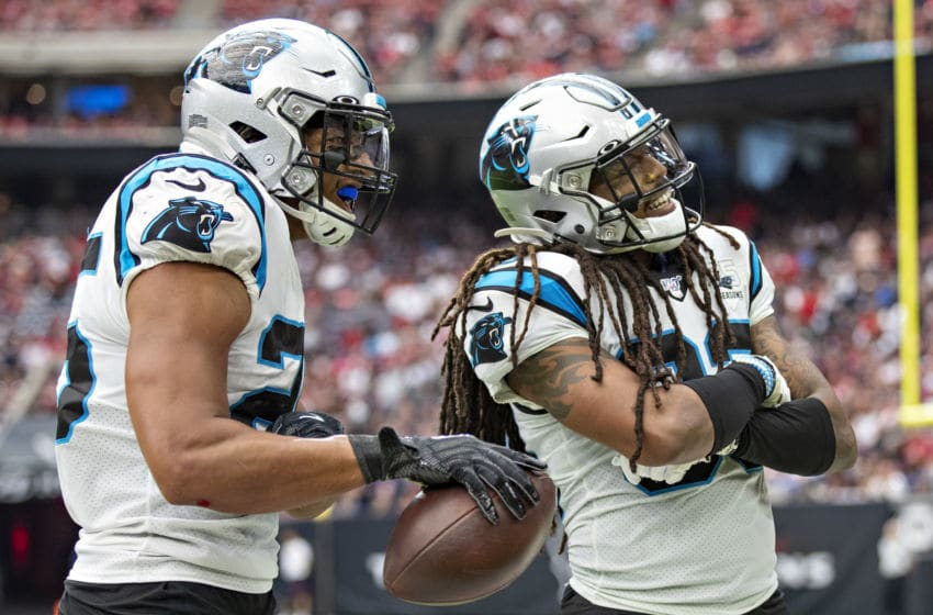 HOUSTON, TX - SEPTEMBER 29: Eric Reid #25 and Tre Boston #33 of the Carolina Panthers celebrate after a fumble recovery during a game against the Houston Texans at NRG Stadium on September 29, 2019 in Houston, Texas. The Panthers defeated the Texans 16-10. (Photo by Wesley Hitt/Getty Images)