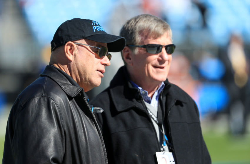 CHARLOTTE, NORTH CAROLINA - NOVEMBER 03: (L-R) Team owner, David Tepper of the Carolina Panthers talks to Panthers General Manager, Marty Hurney, before their game against the Tennessee Titans at Bank of America Stadium on November 03, 2019 in Charlotte, North Carolina. (Photo by Streeter Lecka/Getty Images)