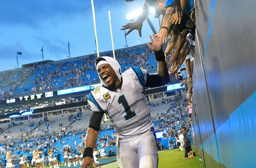 CHARLOTTE, NC - SEPTEMBER 09: Cam Newton #1 of the Carolina Panthers celebrates with fans after their win against the Dallas Cowboys at Bank of America Stadium on September 9, 2018 in Charlotte, North Carolina. The Panthers won 16-8. (Photo by Grant Halverson/Getty Images)