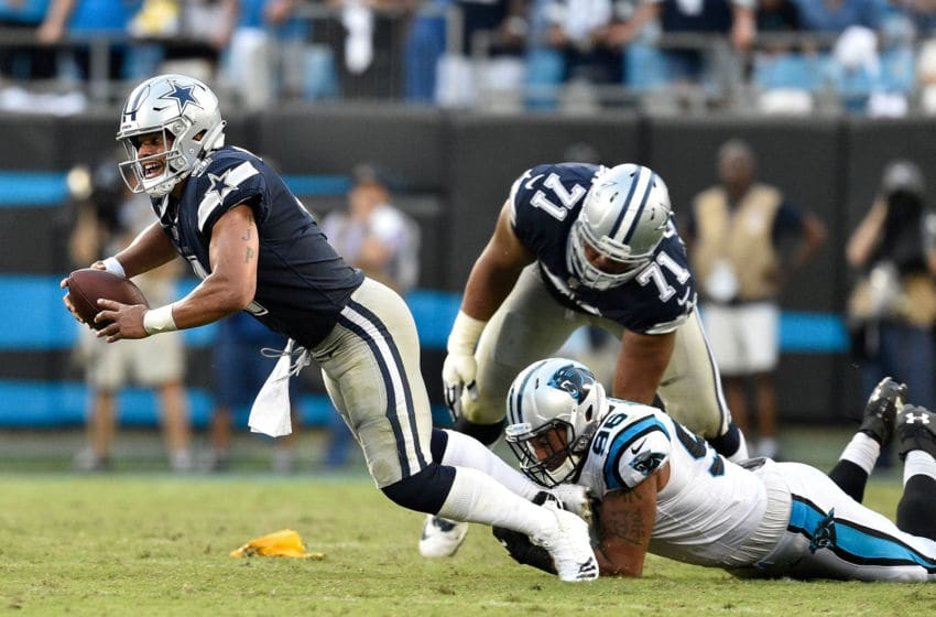 CHARLOTTE, NC - SEPTEMBER 09: Wes Horton #96 of the Carolina Panthers sacks Dak Prescott #4 of the Dallas Cowboys during their game at Bank of America Stadium on September 9, 2018 in Charlotte, North Carolina. The Panthers won 16-8. (Photo by Grant Halverson/Getty Images)