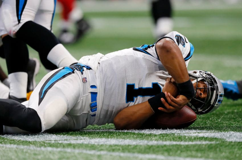 ATLANTA, GA - SEPTEMBER 16: Cam Newton #1 of the Carolina Panthers lays on the ground after a late hit by Damontae Kazee #27 of the Atlanta Falcons during the first half at Mercedes-Benz Stadium on September 16, 2018 in Atlanta, Georgia. (Photo by Kevin C. Cox/Getty Images)