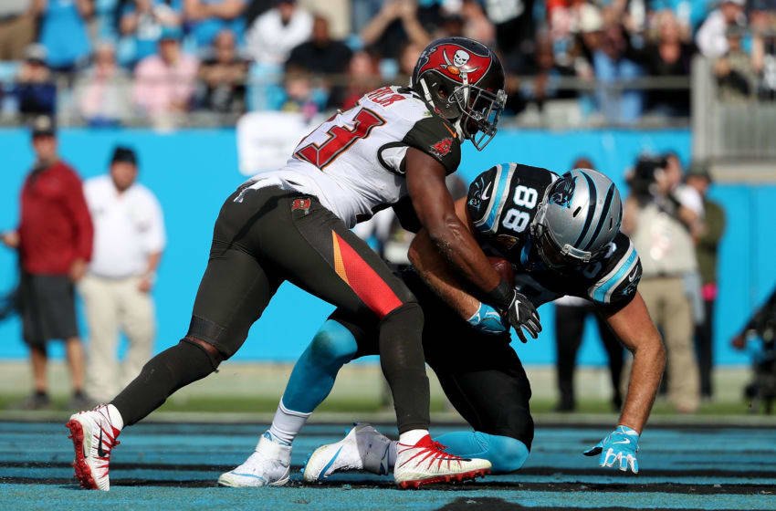 CHARLOTTE, NC - NOVEMBER 04: Greg Olsen #88 of the Carolina Panthers scores a touchdown against Adarius Taylor #53 of the Tampa Bay Buccaneers in the second quarter during their game at Bank of America Stadium on November 4, 2018 in Charlotte, North Carolina. (Photo by Streeter Lecka/Getty Images)