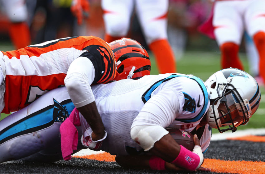 CINCINNATI, OH - OCTOBER 12: Cam Newton #1 of the Carolina Panthers scores a touchdown after being hit by Terence Newman #23 of the Cincinnati Bengals during the third quarter at Paul Brown Stadium on October 12, 2014 in Cincinnati, Ohio. (Photo by Andy Lyons/Getty Images)