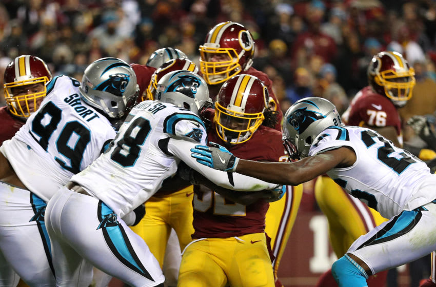 LANDOVER, MD - DECEMBER 19: Running back Rob Kelley #32 of the Washington Redskins scores a second quarter touchdown against outside linebacker Thomas Davis #58 of the Carolina Panthers at FedExField on December 19, 2016 in Landover, Maryland. (Photo by Patrick Smith/Getty Images)