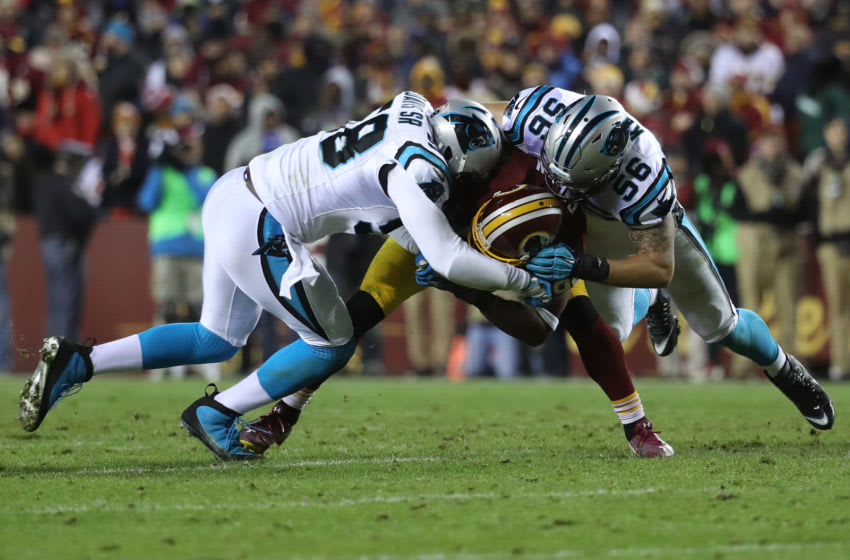 LANDOVER, MD - DECEMBER 19: Wide receiver Pierre Garcon #88 of the Washington Redskins is tackled by middle linebacker A.J. Klein #56 and outside linebacker Thomas Davis #58 of the Carolina Panthers in the third quarter at FedExField on December 19, 2016 in Landover, Maryland. (Photo by Rob Carr/Getty Images)