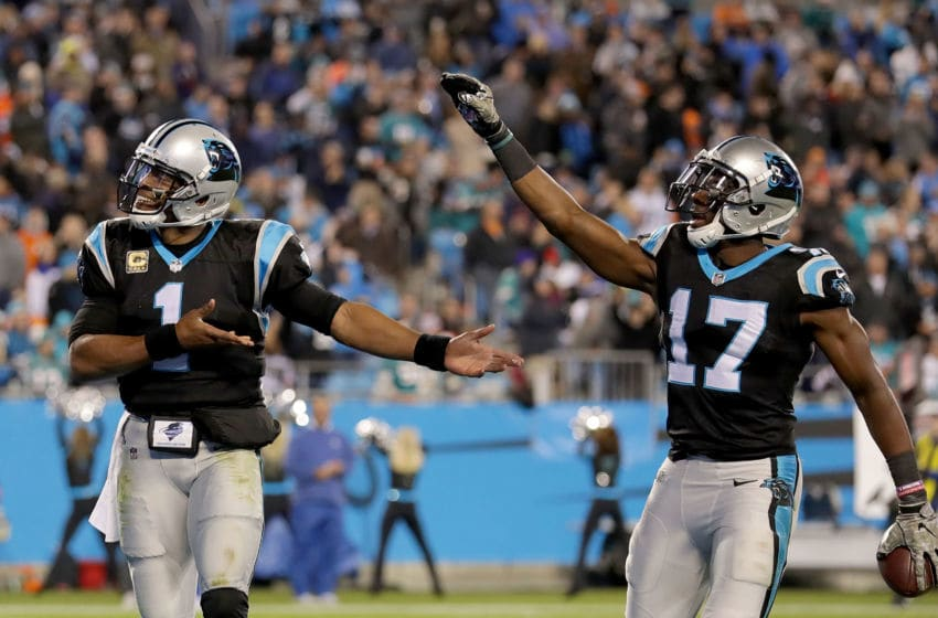 CHARLOTTE, NC - NOVEMBER 13: Cam Newton #1 and teammate Devin Funchess #17 of the Carolina Panthers celebrate a touchdown against the Miami Dolphins in the third quarter during their game at Bank of America Stadium on November 13, 2017 in Charlotte, North Carolina. (Photo by Streeter Lecka/Getty Images)
