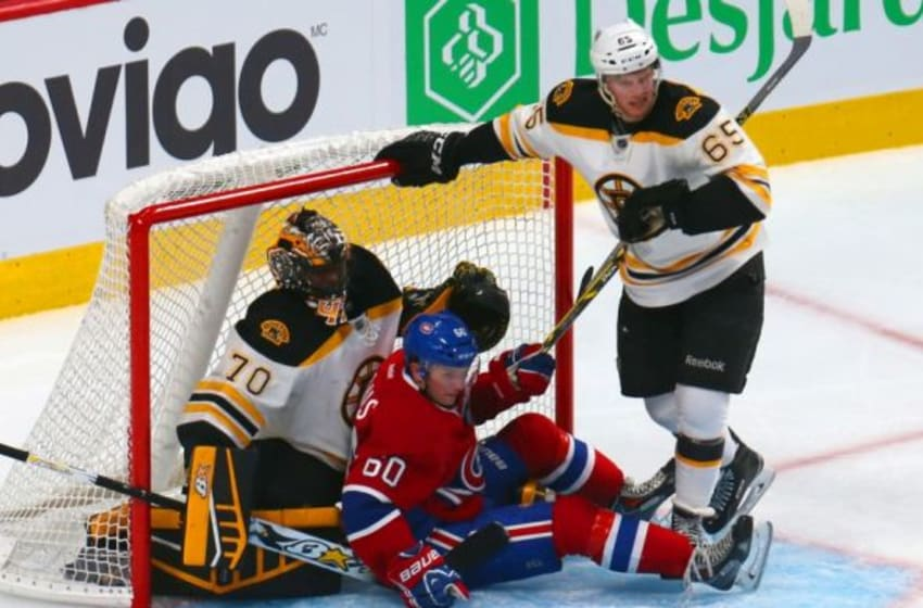 Sep 23, 2014; Montreal, Quebec, CAN; Montreal Canadiens right wing Christian Thomas (60) crashes on Boston Bruins goalie Malcolm Subban (70) as defenseman Chris Casto (65) defends during the third period at Bell Centre. Mandatory Credit: Jean-Yves Ahern-USA TODAY Sports