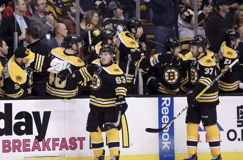 Apr 7, 2016; Boston, MA, USA; Boston Bruins left wing Brad Marchand (63) is congratulated by his teammates on the bench after scoring a goal during the first period against the Detroit Red Wings at TD Garden. Mandatory Credit: Bob DeChiara-USA TODAY Sports