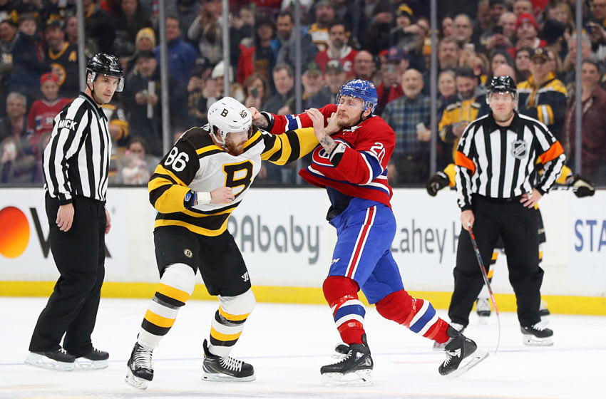 BOSTON, MASSACHUSETTS - JANUARY 14: Kevan Miller #86 of the Boston Bruins fights Nicolas Deslauriers #20 of the Montreal Canadiens during the first period at TD Garden on January 14, 2019 in Boston, Massachusetts. (Photo by Maddie Meyer/Getty Images)