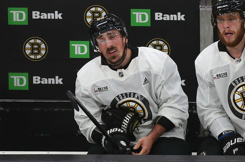 BOSTON, MA - MAY 23: Boston Bruins' Brad Marchand has left glove off in pain on the bench during the first period of a scrimmage ahead of the start of the 2019 NHL Stanley Cup Finals at TD Garden in Boston on May 23, 2019. (Photo by John Tlumacki/The Boston Globe via Getty Images)