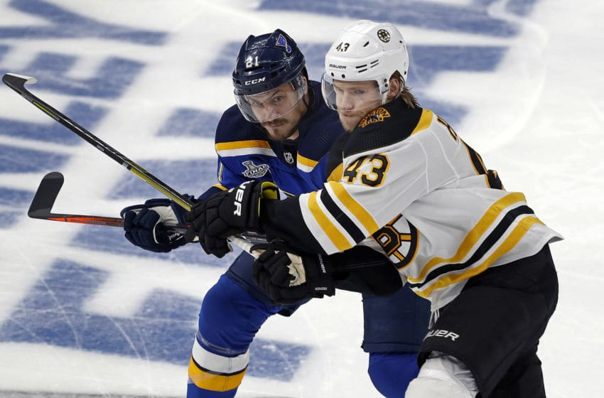 ST. LOUIS, MO - JUNE 3: St. Louis Blues' Tyler Bozak, left, and the Boston Bruins Danton Heinen battle for position early in the first period. The St. Louis Blues host the Boston Bruins in Game 4 of the 2019 Stanley Cup Finals at the Enterprise Center in St. Louis, MO on June 3, 2019. (Photo by Jim Davis/The Boston Globe via Getty Images)